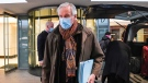 European Commission's chief negotiator Michel Barnier wears a face mask as he leaves his hotel to head back to Brussels, in London, Saturday, Dec. 5, 2020. (AP Photo/Alberto Pezzali)