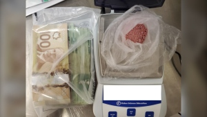 Ontario Provincial Police (OPP) Community Crime Unit executed a search warrant in the Dokis First Nation community on Dec.3, seizing an estimated $8,000 in suspected fentanyl and over $5,000 in Canadian currency. (Supplied photo)