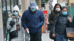 Shoppers walk along Montreal's Sainte-Catherine Street during the COVID-19 pandemic on Thursday, December 3, 2020. THE CANADIAN PRESS/Paul Chiasson