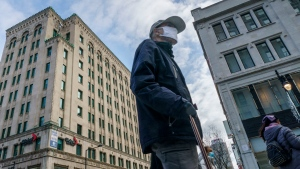 A man walks along Montreal's Sainte-Catherine Street during the COVID-19 pandemic on Thursday, December 3, 2020. THE CANADIAN PRESS/Paul Chiasson