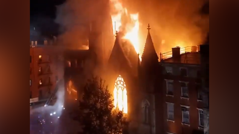 Nearly 200 firefighters were called to fight extinguish a major fire that spread to a century-old church in New York City.