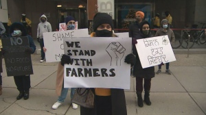 Protesters rallied outside the Indian Consulate downtown on Saturday in support of farmers in India who are protesting new agriculture laws.