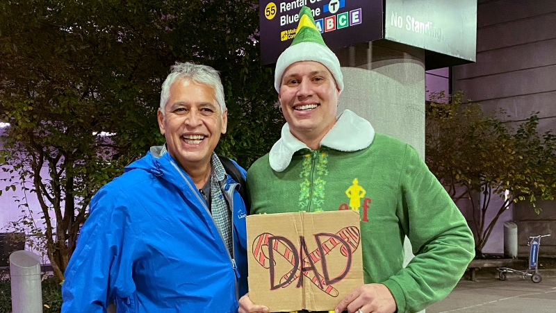 Doug Henning, right, who was adopted as a baby, poses with his biological father after meeting face to face for the first time on Tuesday, Nov. 24, 2020, at Logan International Airport in Boston. (Rebecca Taylor Henning via AP)