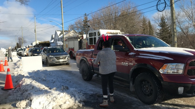 The reindeer might have been absent, but Santa, Mrs. Claus and a team of hard working elves were busy during a three hour drive-by event at The North Bay Food Bank. Dec.5/20 (Alana PIckrell/CTV News Northern Ontario)