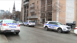 Ottawa police officers investigating a shooting on Nepean Street between Kent Street and Bank Street in Ottawa. Dec. 5, 2020. (Mike Mersereau / CTV News Ottawa)