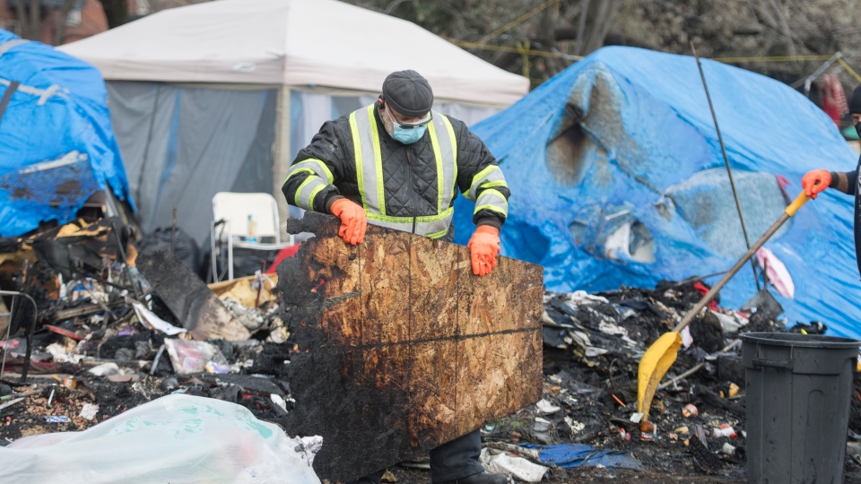 Fire in a tent at the Montreal homeless camp