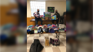 Volunteers put together food baskets and collect warm clothes to giveaway. (courtesy Sherry Bondy)