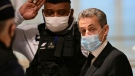Former French president Nicolas Sarkozy (R) arrives for a hearing of his trial on corruption charges on December 7, 2020 at Paris' courthouse. Prosecutors say Sarkozy promised the judge a plush job in Monaco in exchange for inside information on a separate inquiry into claims he had accepted illicit payments from L'Oreal heiress Liliane Bettencourt during his 2007 presidential campaign. Though he is not the first modern French head of state in the dock, Sarkozy is the first to face corruption charges. (AFP)