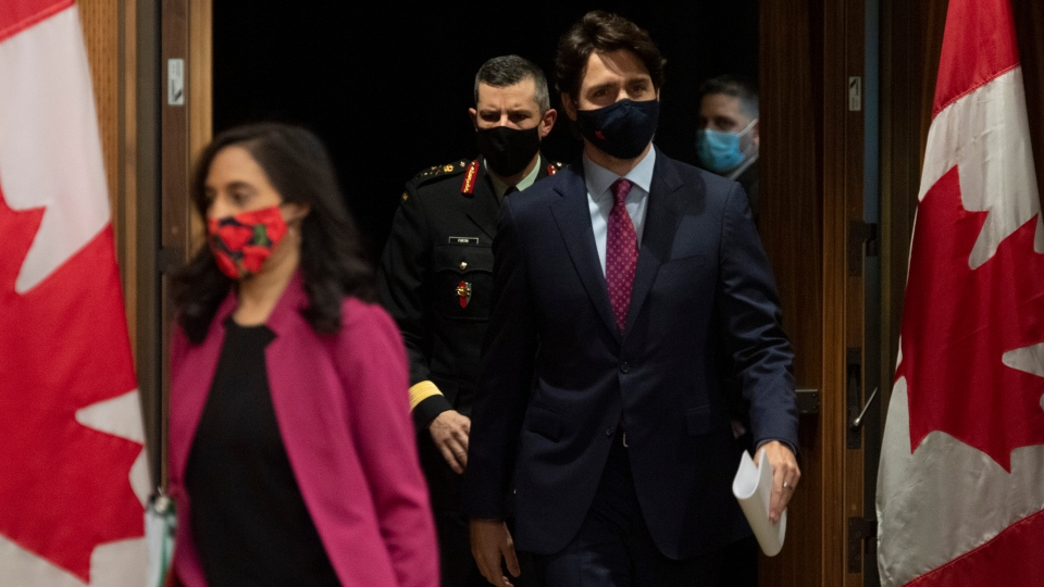 Public Services and Procurement Minister Anita Anand , Prime Minister Justin Trudeau and Major General Dany Fortin arrive for a news conference in Ottawa, Monday, Dec. 7, 2020. THE CANADIAN PRESS/Adrian Wyld