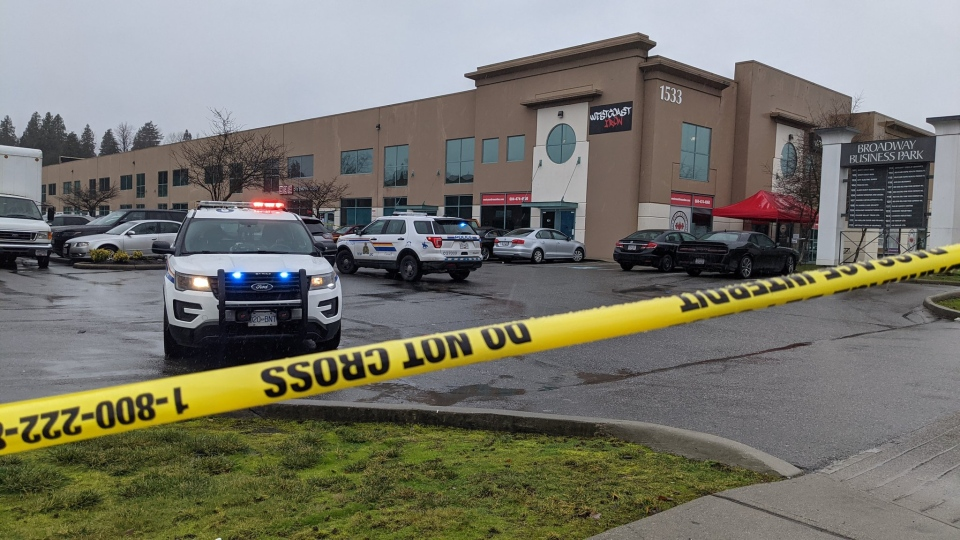 Police tape up around a parking lot after a person was shot in front of West Coast Iron gym in Port Coquitlam on Dec.7, 2020. Source: CTV's Ben Miljure