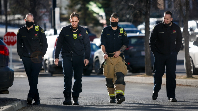Firefighters take a break and walk to a coffee shop in Calgary, Alta., Wednesday, Dec. 2, 2020, amid a worldwide COVID-19 pandemic. THE CANADIAN PRESS/Jeff McIntosh