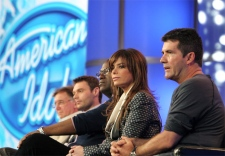 Ken Warwick, executive producer of 'American Idol,' Ryan Seacrest, show's host, and the show's judges Randy Jackson, Paula Abdul and Simon Cowell, from left, answer questions at the 2007 Fox Winter Press Tour in Pasadena, Calif. on on Jan. 20, 2007. (AP / Rene Macura)