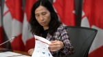 Chief Public Health Officer of Canada Dr. Theresa Tam looks at a copy of the presentation on epidemiology and modelling during a news conference on the COVID-19 pandemic, in West Block on Parliament Hill in Ottawa, on Monday, June 29, 2020. (THE CANADIAN PRESS / Justin Tang)