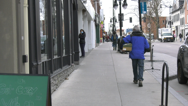 Kingston residents walk down the street wearing masks during the COVID-19 pandemic. (Kimberley Johnson / CTV News Ottawa)