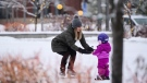 A mom teachers her daughter to skate at Landsdowne Park in Ottawa on Wednesday, Dec. 9, 2020. (Sean Kilpatrick/THE CANADIAN PRESS)