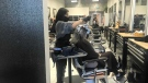 A stylist at Studio Hare in west Edmonton. Dec. 09, 2020. (CTV News Edmonton)