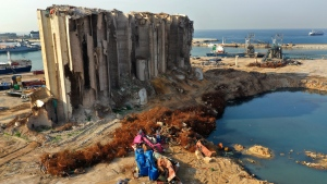Rubble and debris remain around towering grain silos gutted in the massive August explosion at the Beirut port that claimed the lives of more than 200 people, in Beirut, Lebanon, Wednesday, Dec. 2, 2020. (AP Photo/Hussein Malla)