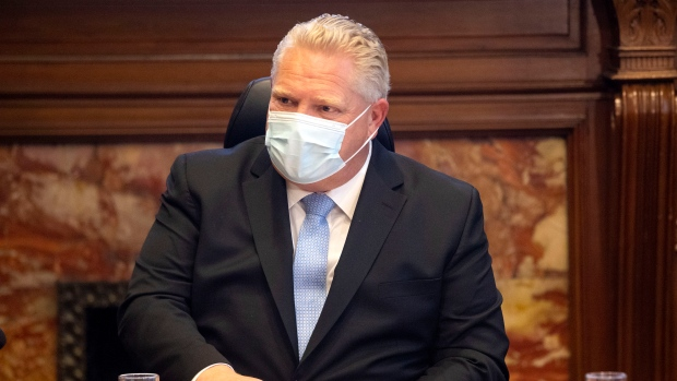 Ontario Premier Doug Ford, right, speaks during a COVID-19 Vaccine Distribution Task Force meeting at the Queen's Park in Toronto on Friday December 4, 2020. THE CANADIAN PRESS/Chris Young