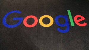 In this Monday, Nov. 18, 2019 file photo, the logo of Google is dipslayed on a carpet at the entrance hall of Google France in Paris. (AP Photo/Michel Euler, File)