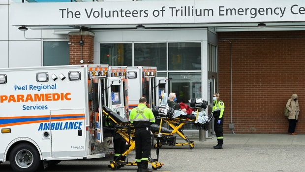 Paramedics transport an elderly man to the hospitals emergency department during the COVID-19 pandemic in Mississauga, Ont., on Thursday, November 19, 2020. (Nathan Denette/The Canadian Press)