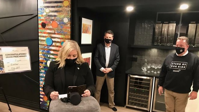 Representatives of London's Hospital Foundations speak with Lori Flynn over speaker phone. Flynn is the grand prize winner of this year's Dream Lottery. (Sean Irvine CTV News)