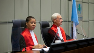 Presiding judge David Re, right, and judge Janet Nosworthy, left, pose for pictures prior to a session of the United Nations-backed Lebanon Tribunal, in Leidschendam, Netherlands, Friday Dec. 11, 2020. (AP Photo/Peter Dejong, Pool)
