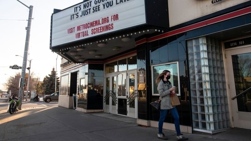 A pedestrian walks past the closed Garneau Theatre in Edmonton on Saturday, December 12, 2020.THE CANADIAN PRESS/Jason Franson