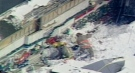 Searchers dig through snow and rubble in this image taken from video of the Lambton Mall roof collapse on Dec 14, 2000. (CTV News London Archives)