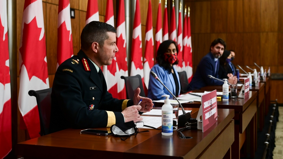 Major-General Dany Fortin, left to right, Minister of Public Services and Procurement Anita Anand, Prime Minister Justin Trudeau, Chief Public Health Officer Dr. Theresa Tam and Deputy Chief Public Health Officer of Canada Dr. Howard Njoo, provide an update on the COVID-19 pandemic in Ottawa on Tuesday, Dec. 15, 2020. THE CANADIAN PRESS/Sean Kilpatrick