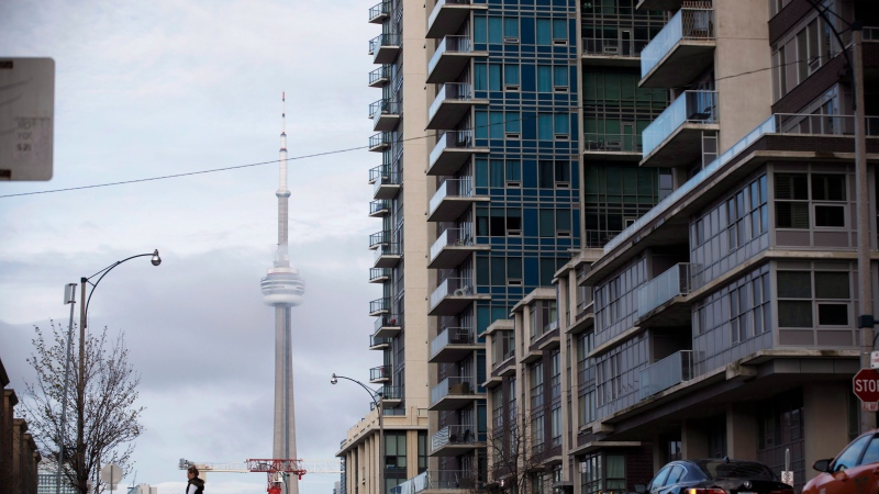 The CN Tower can be seen behind condo's in Toronto's Liberty Village community in Toronto, Ontario on Tuesday, April 25, 2017. THE CANADIAN PRESS/Cole Burston