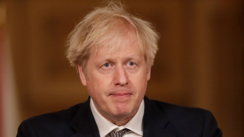 Britain's Prime Minister Boris Johnson speaks during a news conference on the ongoing situation with the coronavirus pandemic, inside 10 Downing Street in London, Wednesday, Dec. 16, 2020. (AP Photo/Matt Dunham, Pool)