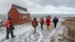 Members of a ground search and rescue team walk along the shore of the Bay of Fundy in Hillsburn, N.S. as they continue the to look for five fishermen missing after the scallop dragger Chief William Saulis sank in the Bay of Fundy, on Wednesday, Dec. 16, 2020. RCAF search and rescue aircraft and Canadian Coast Guard boats have been dispatched as well. THE CANADIAN PRESS/Andrew Vaughan