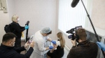 A Russian medical worker administers a shot of Russia's Sputnik V coronavirus vaccine in Moscow on Thursday, Dec. 10, 2020. (AP Photo/Pavel Golovkin)