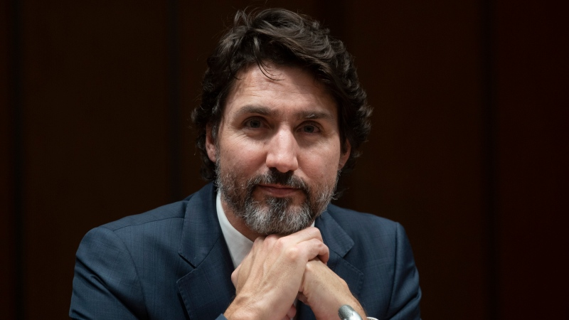 Prime Minister Justin Trudeau listens to a question during a year end interview with The Canadian Press in Ottawa, Wednesday, December 16, 2020. THE CANADIAN PRESS/Adrian Wyld