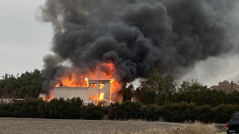 A house is engulfed by flames on Pain Court Line in Chatham-Kent on Wednesday, Dec. 16, 2020. (Courtesy Chatham-Kent Fire)