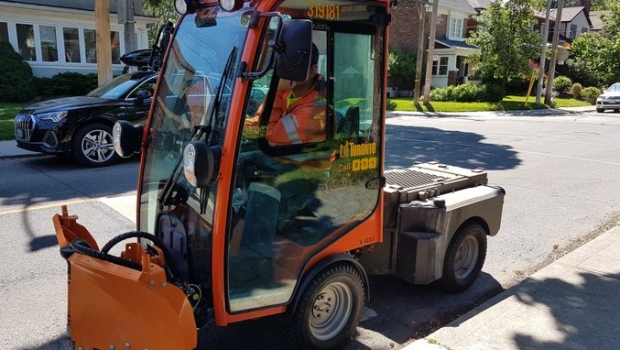 The City of Toronto's new mini snowplow machines will be used this winter to help clear snow in some of the city's narrower sidewalks. (AlexColangelo/Twitter)