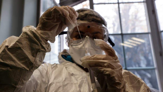 A medical student secures a swab following antigen testing at the Emile Dubois high school in Paris, Monday Nov. 23, 2020. (Ludovic Marin, Pool via AP)