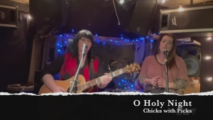 Sudbury's Chicks with Picks — Melanie Morin and Nancy Palladino – sing, 'O Holy Night.'