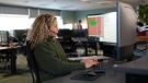 An E-Comm call-taker is seen in a handout image provided by the dispatch centre.