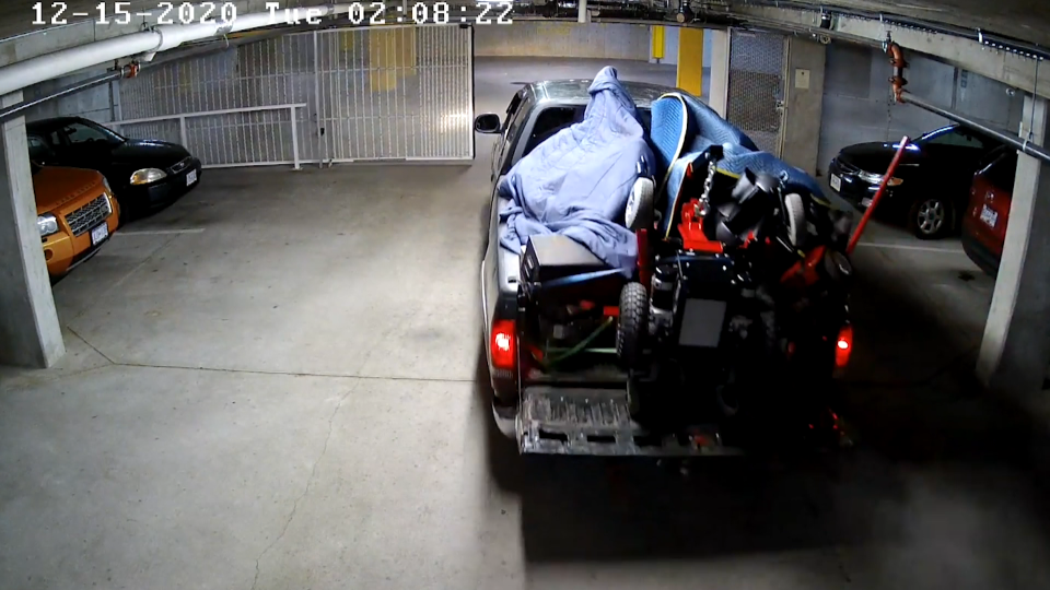 Surveillance video shows a pickup truck full of stolen goods leaving a condo parking lot in Delta, B.C. on Dec. 15, 2020.