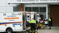 Paramedics transport an elderly man to the hospitals emergency department during the COVID-19 pandemic in Mississauga, Ont., on Thursday, November 19, 2020.