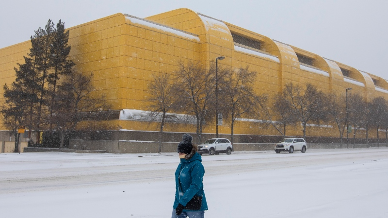A pedestrian walks past the University of Alberta Butter Dome which is being turned into a field hospital to help with COVID-19 patients in Edmonton Alta, on Thursday December 17, 2020. THE CANADIAN PRESS/Jason Franson