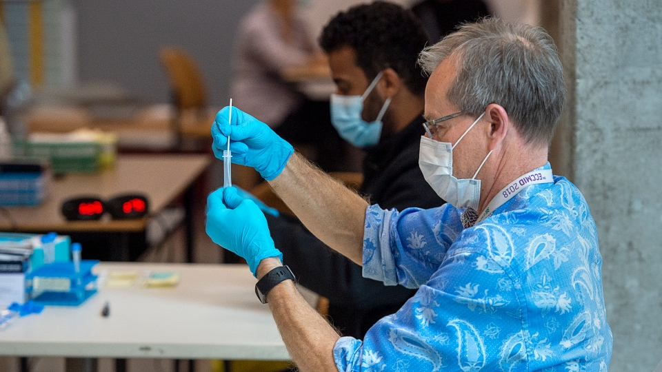 A nasal sample is processed at a pop-up COVID-19 testing site on the Dalhousie University campus in Halifax on Wednesday, Nov. 25 2020. (THE CANADIAN PRESS/Andrew Vaughan)