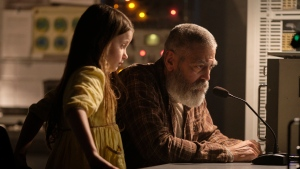 "This image released by Netflix shows Caoilinn Springall, left, and George Clooney in a scene from ""The Midnight Sky."" (Philippe Antonello/Netflix via AP)"