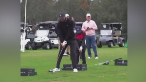 Tiger and Charlie Woods swing golf clubs in sync