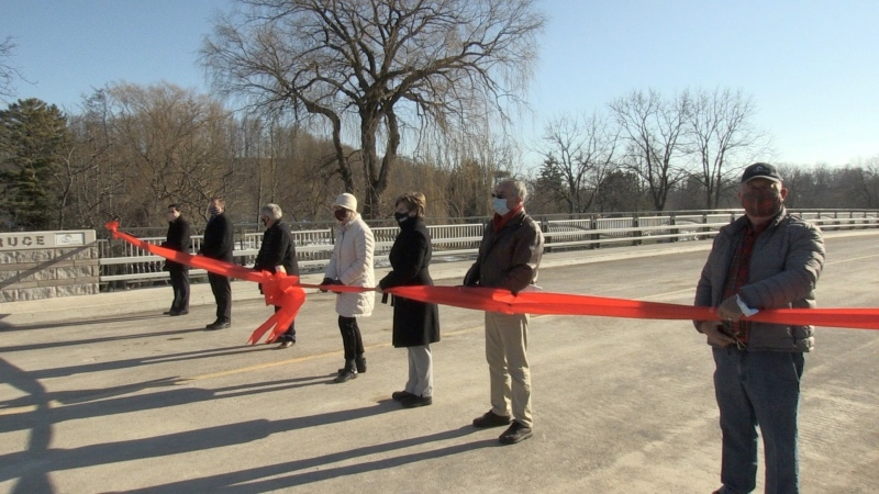 Dignitaries cut the ribbon to reopen the Imperial Road bridge in Port Bruce, Ont. on Friday, Dec. 18, 2020. (Jim Knight / CTV News)
