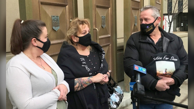 Homicide victim Shane Smith's sister, Cassandra Smith, mother Shirley Smith and dad Bill Smith speak outside court on Friday Dec. 18, 2020.