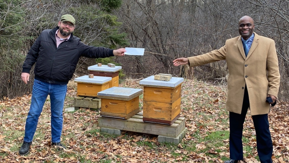 Beekeeper Peter Andersen with St. Aidans Church