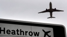 FILE - In this file photo dated Tuesday, June 5, 2018, a plane takes off over a road sign near Heathrow Airport in London. The U.K. is banning travel from four additional countries as a result of the COVID-19 pandemic. (AP Photo/Kirsty Wigglesworth, file)