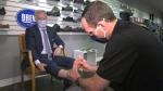 Christian Johannsen takes a look at Ross' feet.